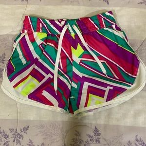 Bright, geometrically patterned athletic shorts